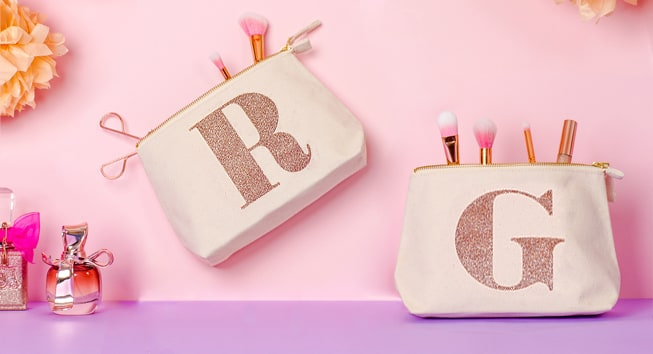 Rose gold glitter initial makeup bags