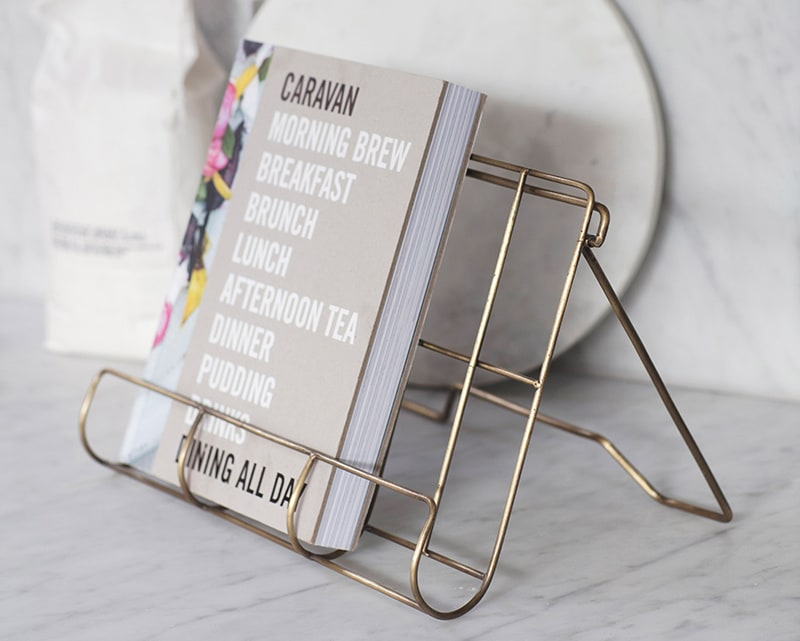 Brompton Antique Brass Finish Cook Book Holder with cook book on kitchen counter