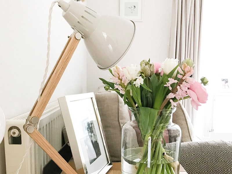 Chalk Bermondsey Table Lamp and Broadwell vase filled with spring flowers on side table