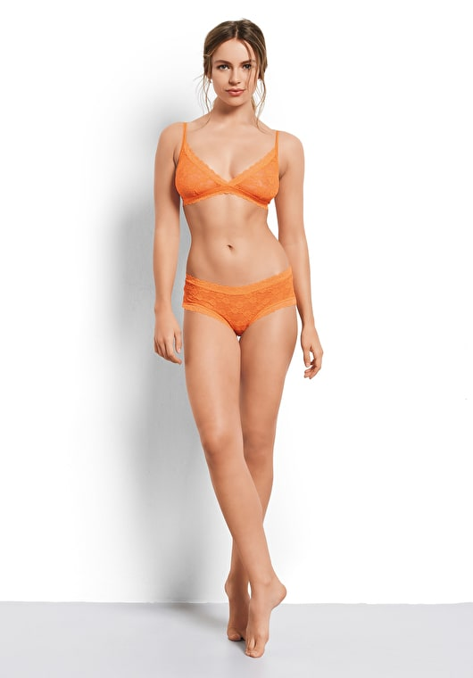 Model wears our lace knickers with a scalloped trim in neon orange