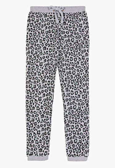 Green leopard print joggers with rolled up cuffs
