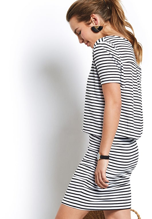 Model wears our Tara dress is made up of a tight skirt and a v neck tee, in a beautiful black and white stripe