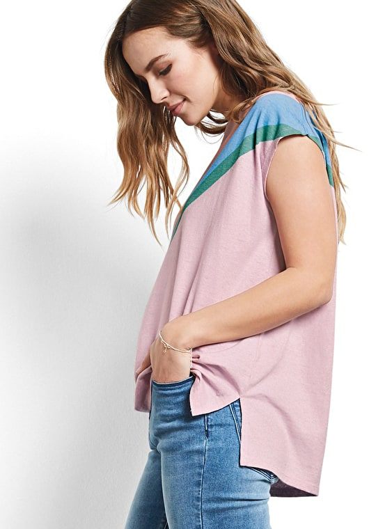 Model wears our Oversized boxy tee in a pastel rainbow design in light pink