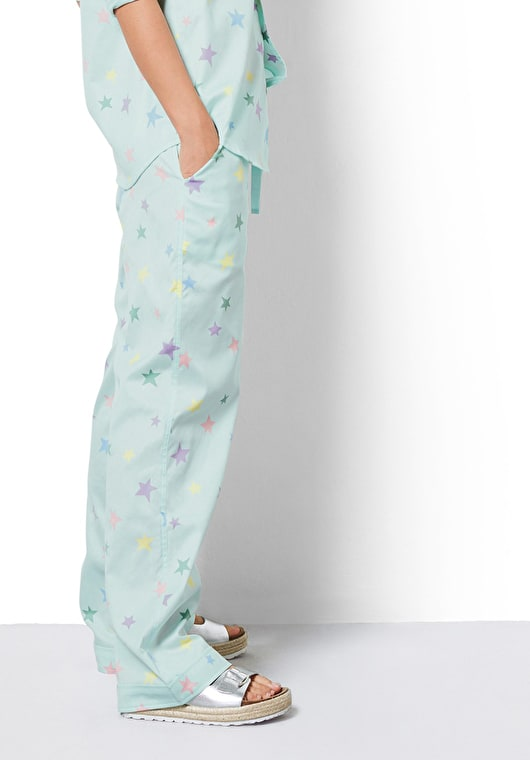 Model wearing our Mint Green pyjama set with multi coloured pastel stars