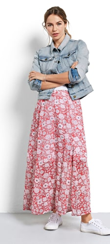 Model wears our Floral maxi skirt with side splits with a coral and hibiscus wild flower print