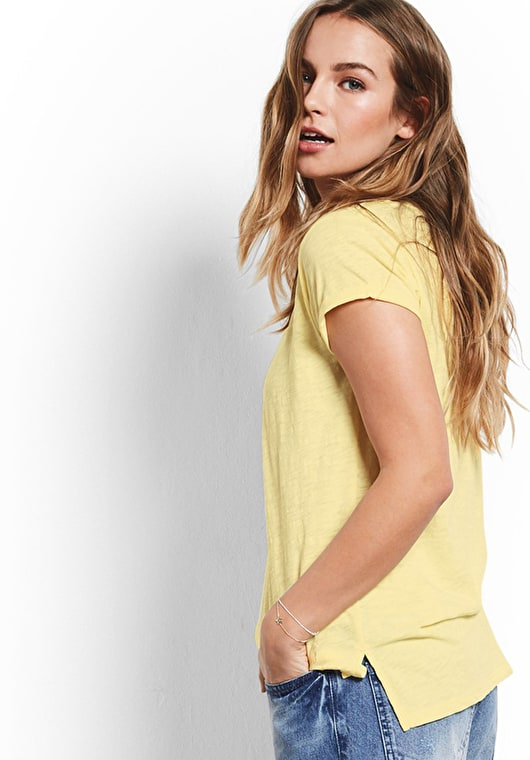 Model wears our Classic cotton crew neck tee in pastel yellow