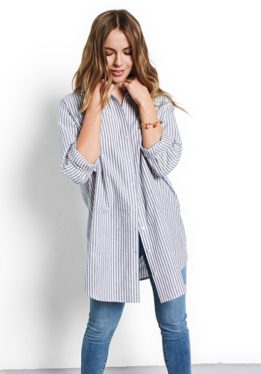 Model wears our Oversized striped shirt with metallic embellished stripes in blue and white