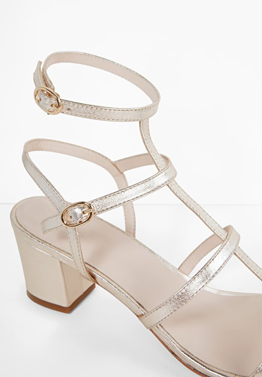Light gold t bar sandals with multiple straps buckle fastening and a block heel