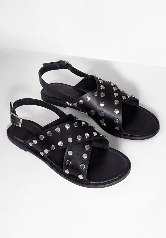 Cross over studded sandals with buckle fastening in black