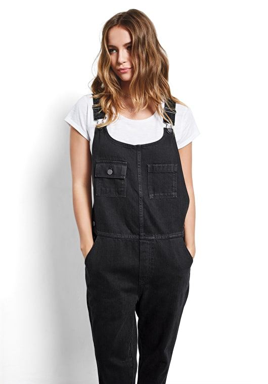Model wears our Semi relaxed fit dungarees cropped above the ankle in black denim