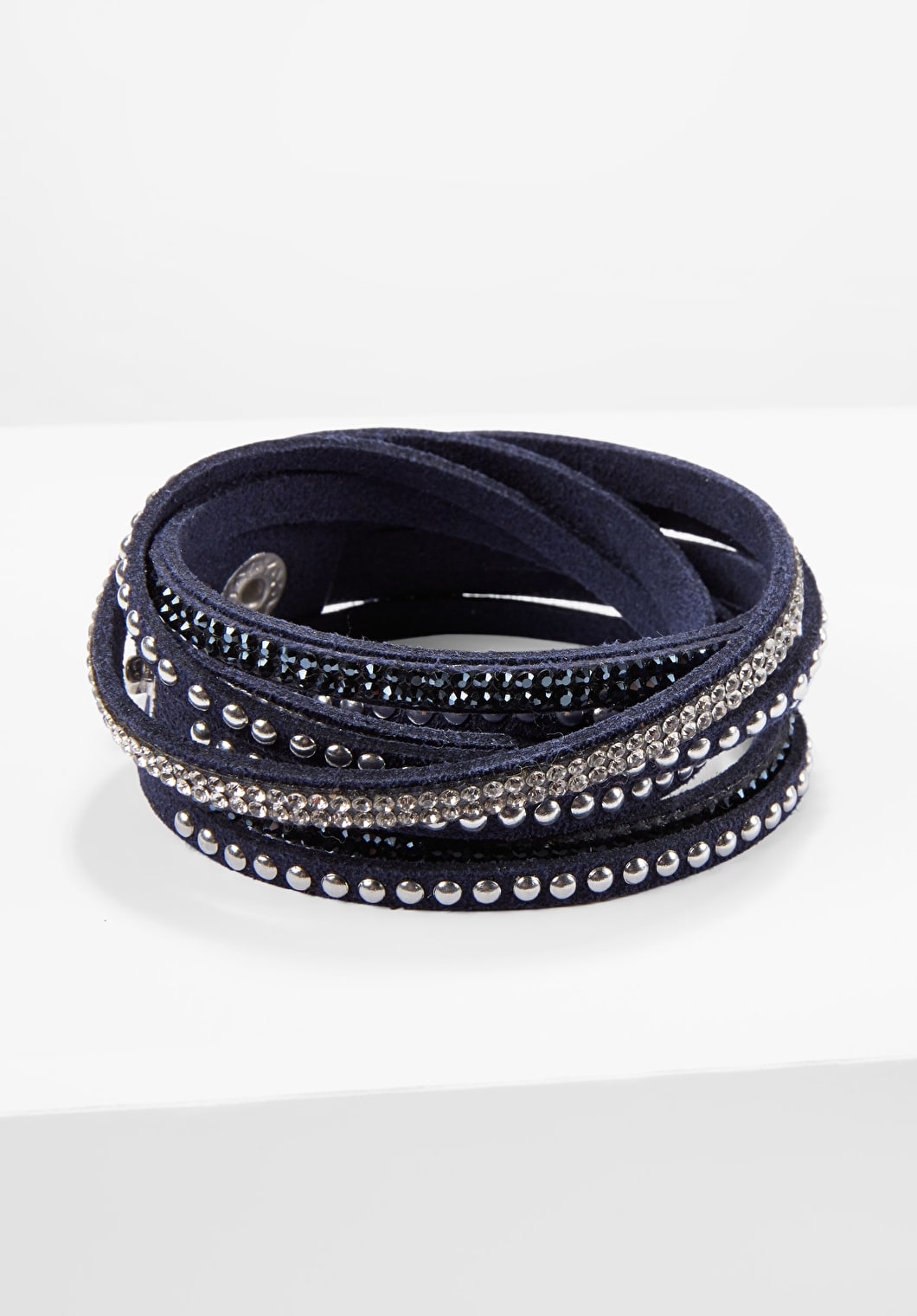 Wrap around crystal bracelet with studs in a stunning navy faux suede colour