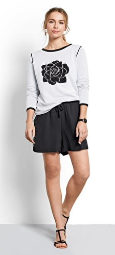 Model wears our bold rose motif in monochrome in the centre of this reversable jumper in black and white