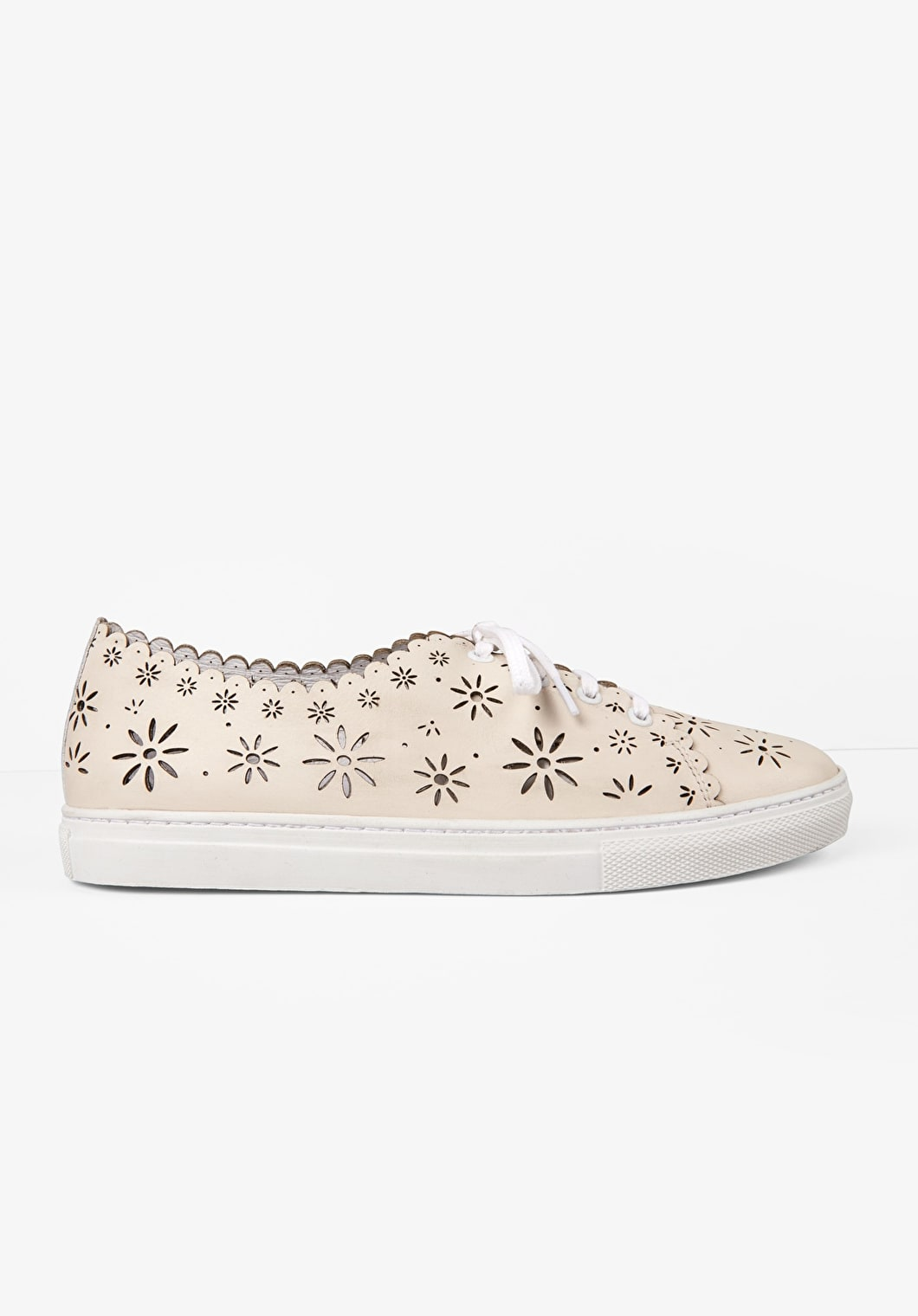 Floral cut out leather lace-up trainers with a scalloped trim in cream