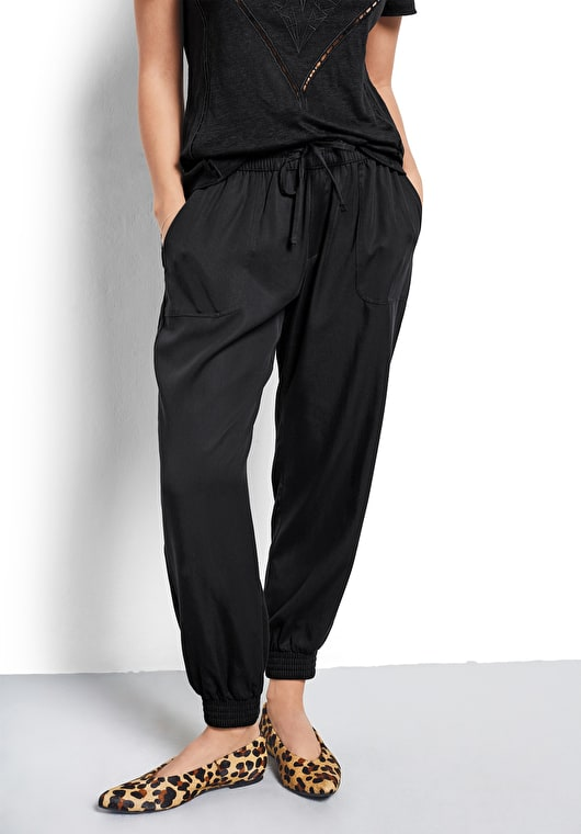 Model wears our relaxed fit sport look trousers with an elasticated waistband in black