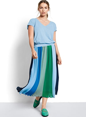 Model wears our Striped colourblock pleated maxi skirt in shades of blue and green
