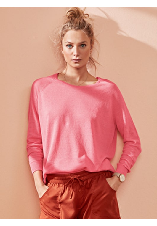 Model wears our lightweight knitted boyfriend jumper in a bubblegum pink