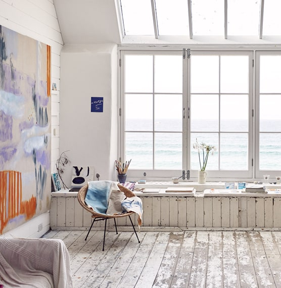 Photo from inside Porthmeor studios looking out the window showing the sea outside.
